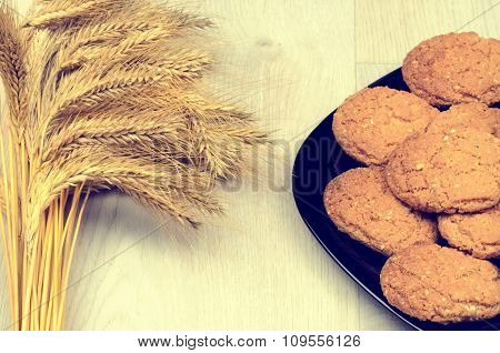 Wheat Ears And Cookies On A Wooden Background