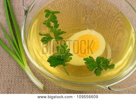 Broth with egg and parsley