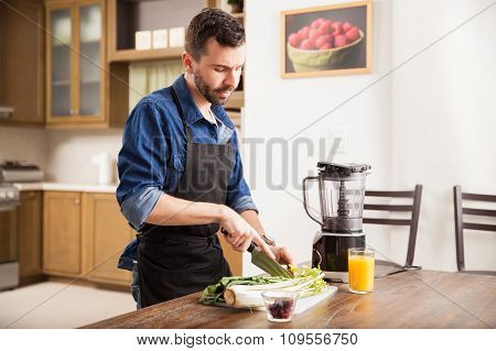 Man Preparing A Green Smoothie