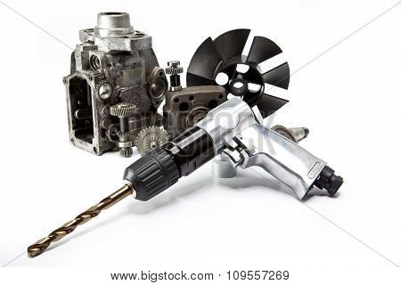 Car repair - details of the pump of high pressure and air drill on white background