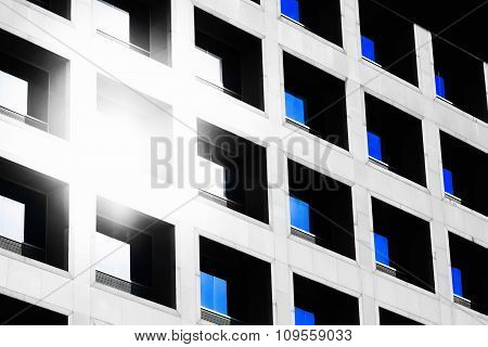 The Reflection Of The Sun And Blue Sky Mirrored In A Modern Building Window