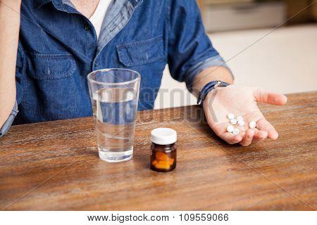 Taking Some Pills For A Headache