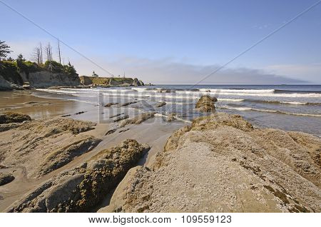 Rocks And Waves On A Sheltered Beach
