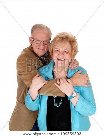 Older Couple Hugging .