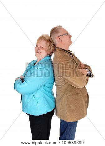 Older Couple Standing Back To Back.