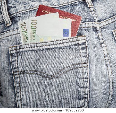 Slice Of A Cover Of The Russian Passport And Two Notes Hundred Euros In A Hip-pocket Of Blue Jeans