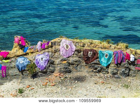 Clothes From Local People Keep Drying At A Rock