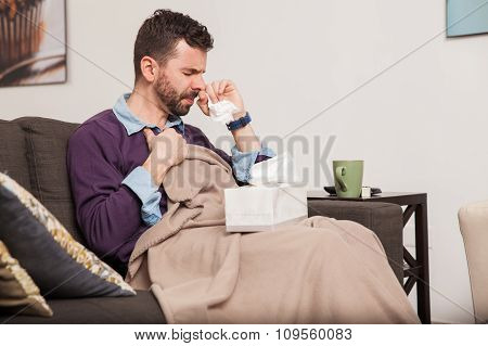 Man Fighting A Cold At Home