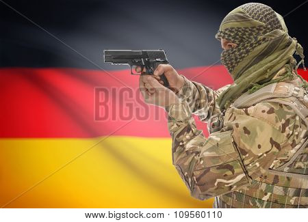 Male In Muslim Keffiyeh With Gun In Hand And National Flag On Background - Germany