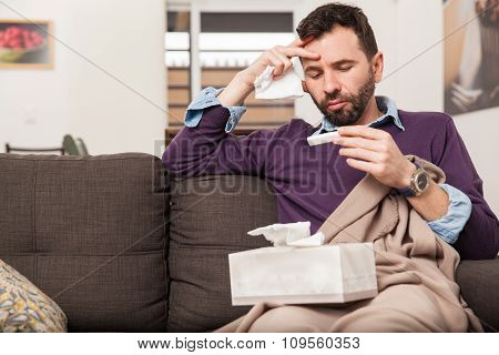 Guy With A Cold And Fever At Home