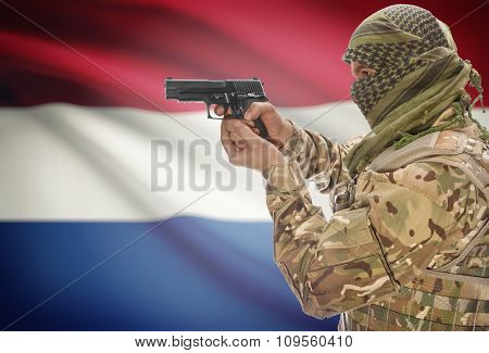 Male In Muslim Keffiyeh With Gun In Hand And National Flag On Background - Netherlands