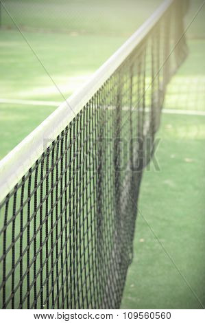 Paddle or tennis net in the tennis court.