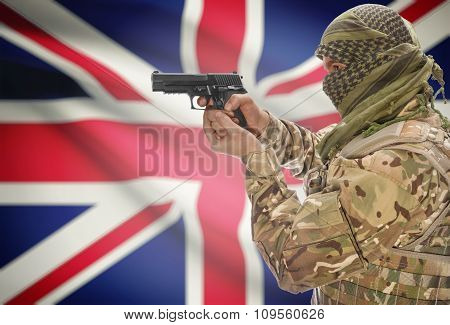 Male In Muslim Keffiyeh With Gun In Hand And National Flag On Background - United Kingdom