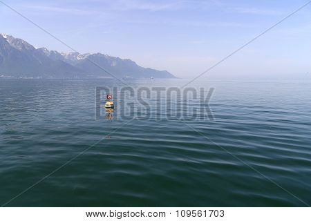 Quiet Lac Leman and Swiss Alps with snow caps near Montreux in Switzerland in summer
