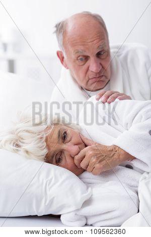 Sad Elderly Wife In Bed