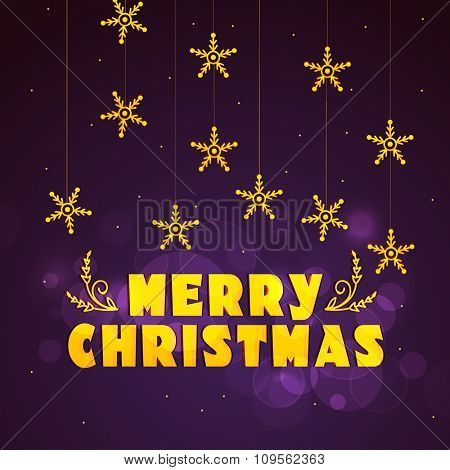 Elegant greeting card design decorated with hanging golden snowflakes on shiny purple background for Merry Christmas celebration.