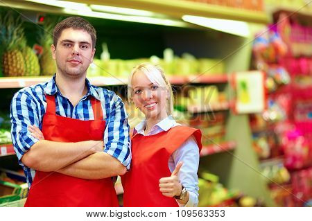 Smiling Grocery Staff Working In Supermarket