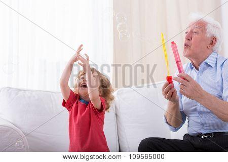Grandfather Letting Bubbles