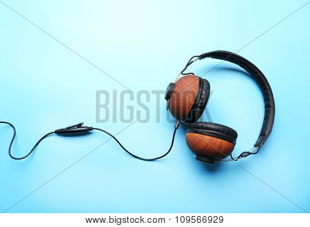 Black and brown headphones on blue background