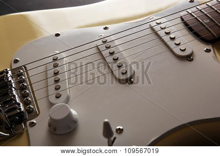 View on white electric guitar's body, close-up