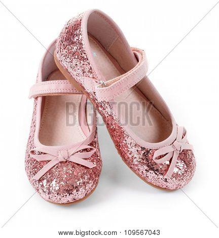 Shiny pink girls shoes isolated on white background