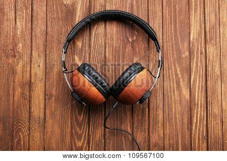 Headphones on brown wooden background