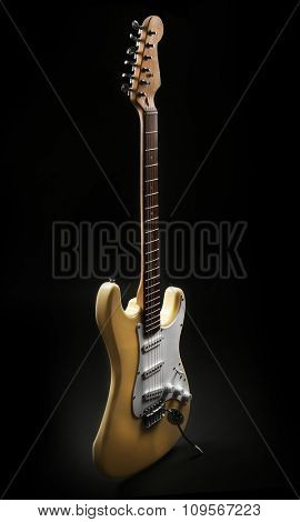 White electric guitar, on black background