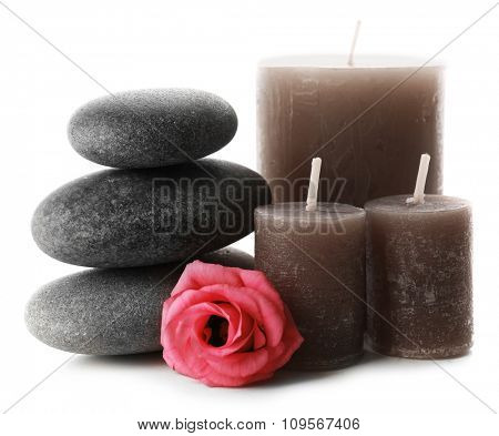 Aroma candles with pebbles and flower isolated on white background