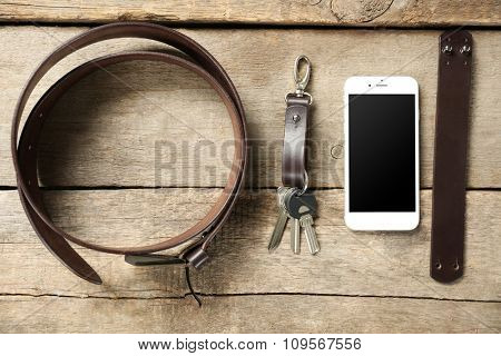 Fashionable accessories on wooden background