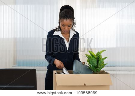 Businesswoman Carrying Box With Her Belongings