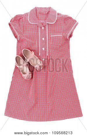 Shiny pink shoes and red plaid shirt isolated on white background