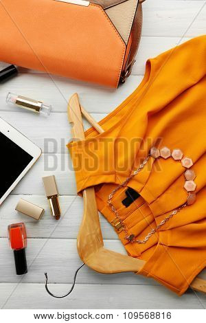 Bright fashion look on wooden background, close up