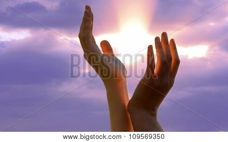 Hands on sunlight background