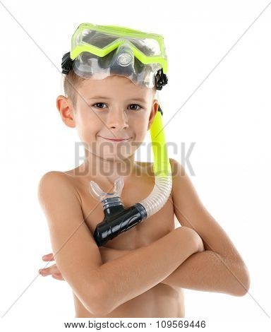 Happy boy with yellow diving mask poses in studio on white background