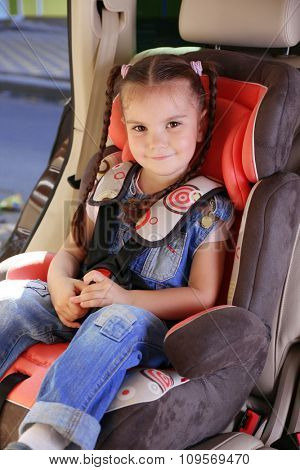 Cute little girl sitting in the car