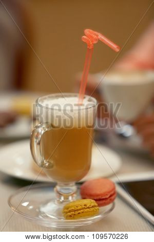 Cup of latte on a table closeup