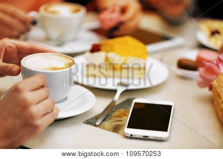 Woman with a tablet and coffee in cafe