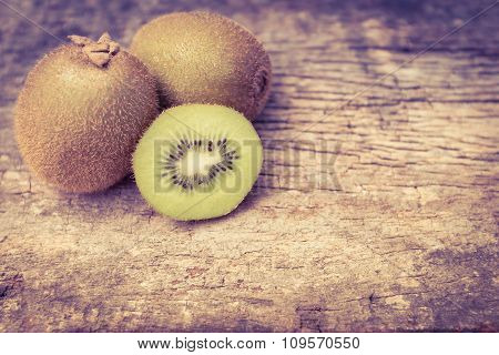 Close Up Fresh Kiwi Fruit On Old Wood Background.