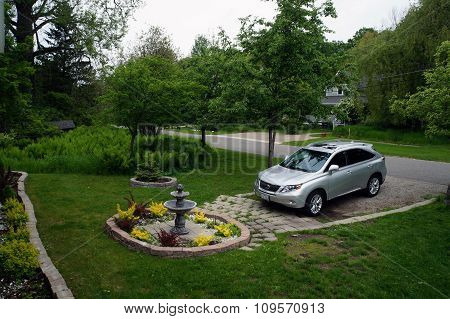 Lexus Parked by a Garden