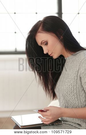 Beautiful woman at home with a tablet