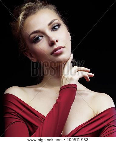 beautiful rich blond woman in elegant dress on black background close up