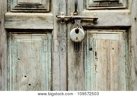 Old wooden door shut with a lock in Kathmandu, Nepal