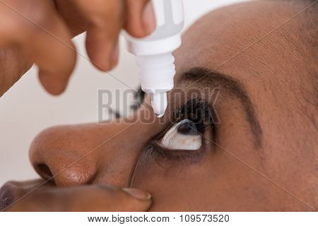 Woman Using Eye Drop
