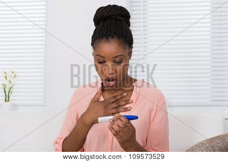 Shocked Woman With Pregnancy Test Kit