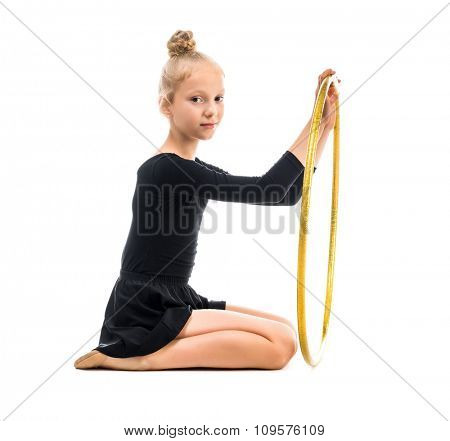 little gymnast doing exercise with hoop isolated on white background
