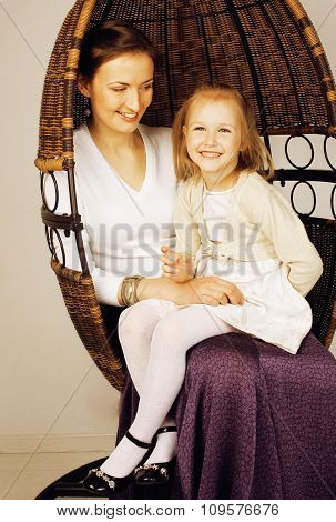 young mother with daughter at luxury home interior vintage