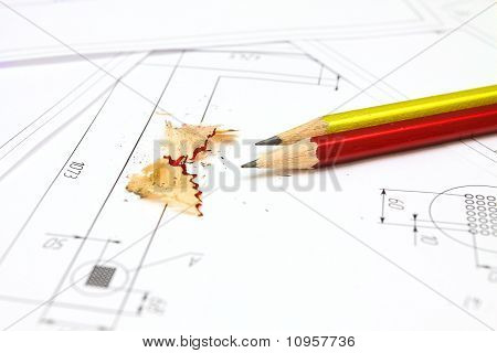 Two Pencils, Plans And Blueprints For An Architect's Design Drawings