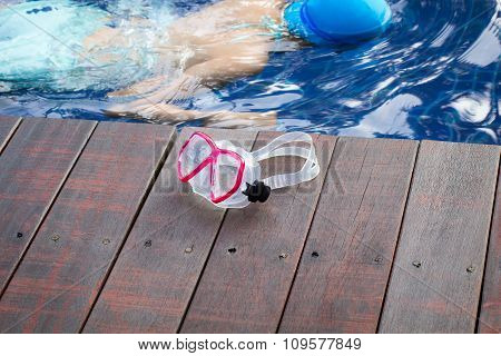 goggles on the wood poolside recreation