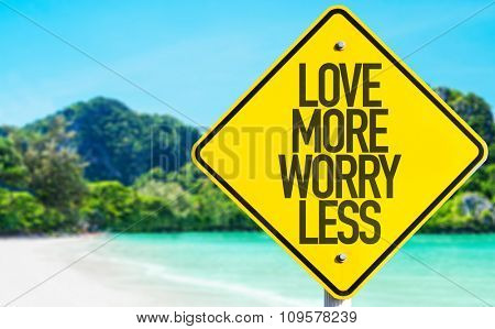 Love More Worry Less sign with beach background