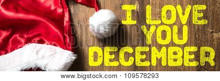 I Love You December written on wooden with Santa Hat